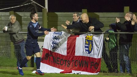 James Hall celebrates scoring for St Neots Town in their 3-2 win at Kings Langley. Picture: CLAIRE H