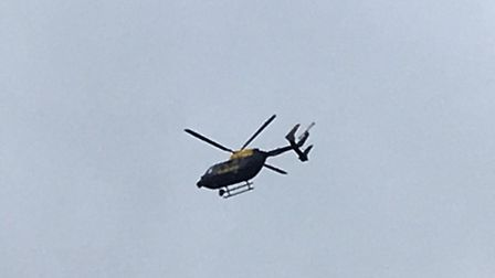 A police helicopter is searching for person who fled scene of Folly Lane crash