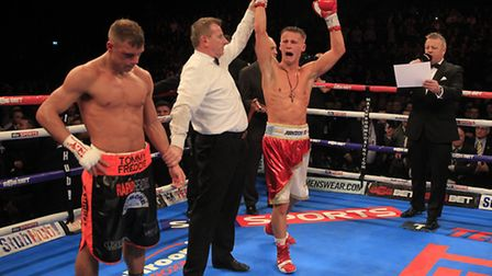 Tommy Martin's finest moment as he became the youngest fighter to ever lift the English light-welter
