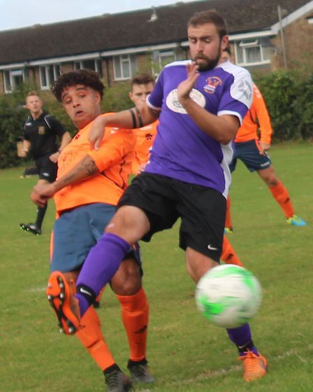 Six Bells' Jermain Davey gets in a shot under pressure from Stefan Day of Phoenix Res