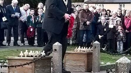 St Neots mayor Derek Giles laying a wreath at the war memorial in St Neots