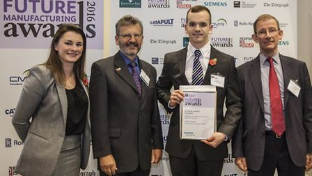 Michael Dunstan, third from left, with his award.