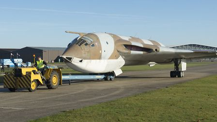 The Handley Page Victor XH648 being moved along the airfield taxiway at IWM Duxford. Picture: IWM D