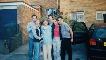 Alun with his mum and siblings outside the family's old house in Newport