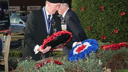 Don Dell of the Royal British Legion lays a wreath at the remembrance day service at St Peter's war