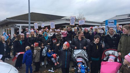 Parents and teachers protest against government funding proposals outside Huntingdon Nursery School