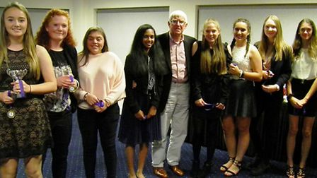 The Hunts Under 15 Girls team receive their medals and trophy for winning the ECB Development Group