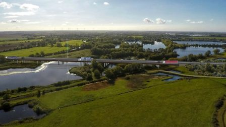 An artist's impression of how the new A14 could look as it crosses the River Great Ouse.
