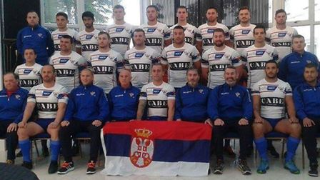 The Serbian side with St Albans Centurions' physio Leonard McMain