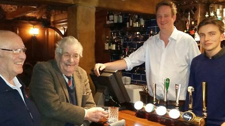Peter Hancock, 2nd from left, enjoys a chat with friendly staff at The White Horse Inn, Duns Tew, in