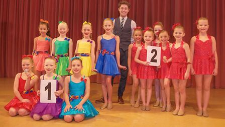 Event winners Stage Right with second place team Britton, with festival adjudicator Billy Mahoney.