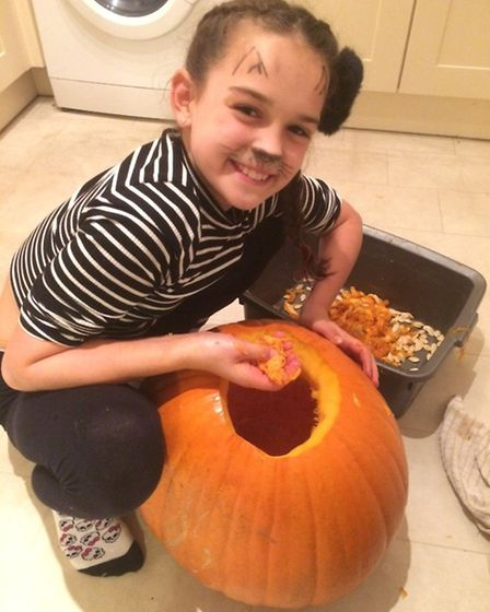 Mia, carving the pumpkin before it was stolen last night (October 30).