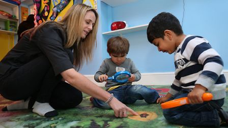 Nursery manager and owner Amanda Griffiths with 2-3 year olds from red monkey pre school room on the