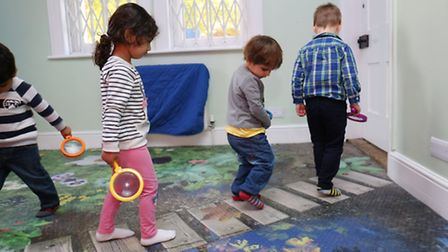 2-3 year olds from red monkey pre school room play on the new floor at Monkey Puzzle Day Nursery.