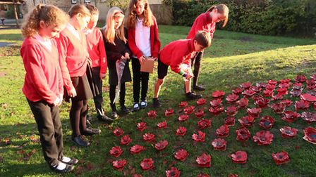 Houghton Primary School pupils with their ceramic poppies.