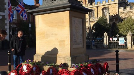 Thinking Soldier memorial covered with wreaths following Huntingdon's service of remembrance