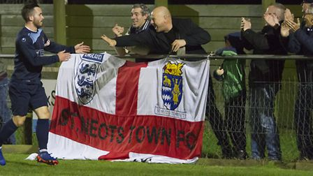 James Hall celebrates with fans after scoring for St Neots Town in their recent win at Kings Langley
