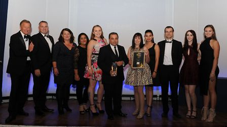 The Kinesis team collect their Business of the Year Award