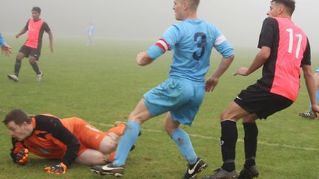 Aidan Golds, Blacksmiths Arms (right) scores one of his two goals against Facelad watched by Facelad