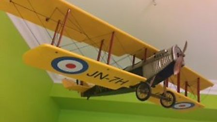 The plane hanging in Kathy's son's bedroom