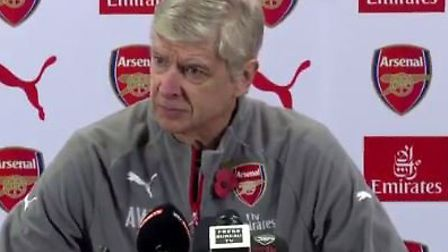 Arsene Wenger at his weekly press conference at London Colney, wearing a poppy. Photo courtesy Twitt