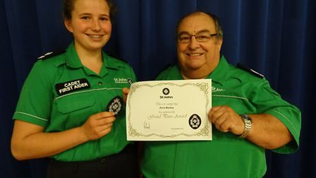 Alice receiving her award from Brian Heron-Edmends
