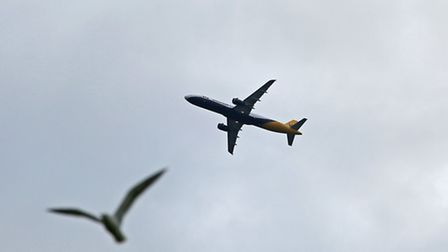 A plane taking off from Luton airport passes over Stevenage.