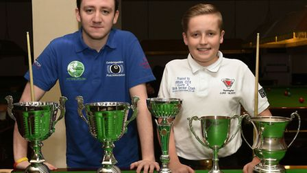 Dom Cooney (left) and Luke Gilbert show off their trophies.