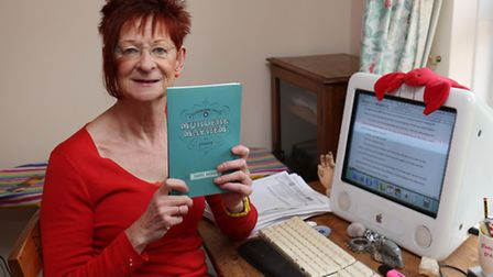 Author Carol Hedges with her latest book.