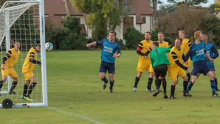 A Brampton effort is headed off the line during their derby success against Hemingfords United. Pict