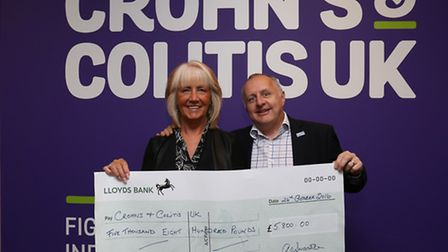 Fundraiser Ann Swanston presents a cheque for £5,800 in memory of her late husband to Crohn's and Co