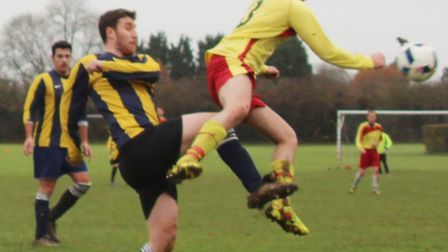 An Oaks defender clears under pressure from an Athletico Quat player