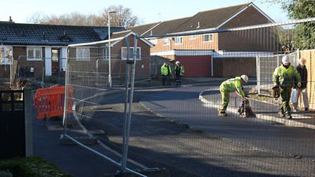 Resurfacing work taking place on Fontmell Close after the sinkhole repair.