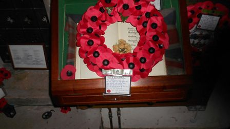 The wreath on the book of remembrance