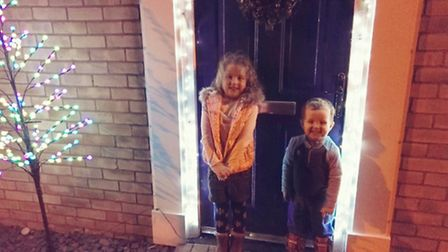 Willow and Ethan with the family Christmas tree before it was stolen