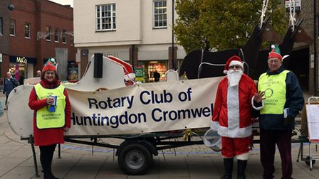 Rotarians Dee Wormald and John Sadler with Father Christmas, in Huntingdon.
