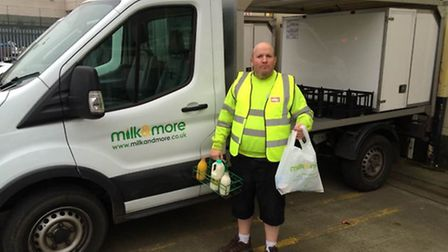 Milkman John Cooper who found a stolen handbag and used Facebook to find it's owner.