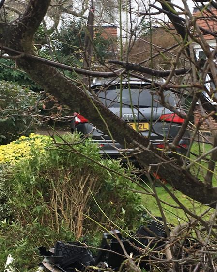 The Audi was later removed from the garden with a recovery truck