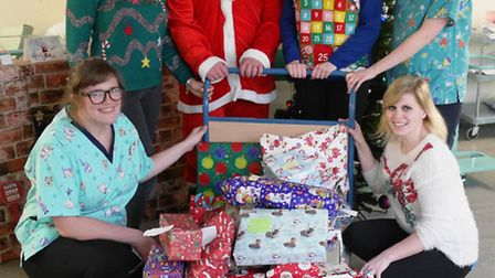 Hinchingbrooke Hospital staff with The Hunts Post team, Santa and Robyn Hall from Luminus