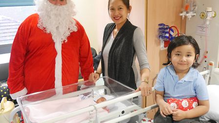 Santa with mum Agnes Calsas, baby Chelsea and brother Fordia