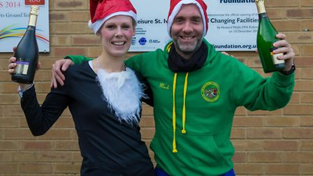 Claire Webster and Mark Wishart won the Hunts AC Christmas Cracker race in St Ives.