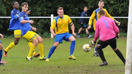 Tony Golder was sent off, along with Sam James, but Harpenden Town held on to beat Harefield United.