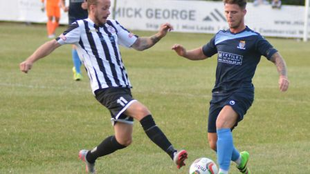 Josh Dawkin (left) struck for St Ives Town in their draw at Weymouth.