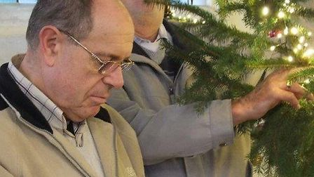 Lay reader Tony Mills, foreground, and former town councillor Bob Smith decorating the tree which wa