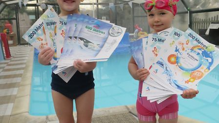 Lilia Faith Semerene, four, and Emilia Wright, aged three, with their swimming certificates.