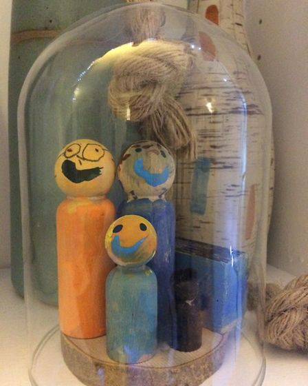 These peg dolls, made by Claire's five-year-old daughter a year ago, are a favourite ornament