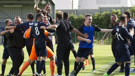 St Neots Town players and management celebrate a winning goal against Frome earlier in the season. T