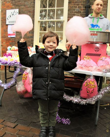 Defying the rain, Ethan Carrier with his candy floss. Picture: Clive Porter