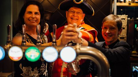 Mayor of Royston, Sarah Dingley, town crier Graham Pfaff and Rev Heidi Huntley pull the first pints