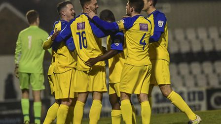Matt Ball starts the celebrations after sending St Albans City through to the next round of the Hert